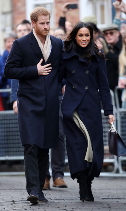 <p>A few days after their engagement announcement, Prince Harry and Meghan Markle made their first official joint visit in Nottingham, UK on December 1, 2017. The two spent the day celebrating World AIDS Day and visiting youth and mentors at the Full Effect Program. The Prince and the actress were met by huge crowds, including royal watchers and press, who came to the city to catch a glimpse of the happy couple. Under her navy blue Mackage coat, Meghan styled a classic black shirt by Wolford, a stylish nude midi skirt by Joseph, and black tall boots.</p>