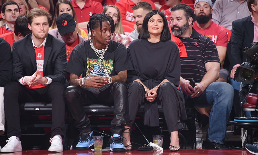 <p>New parents Travis Scott and Kylie Jenner took a night off of parenting duties to take in a basketball game! The two looked happy as clams sitting courtside on April 18.</p>