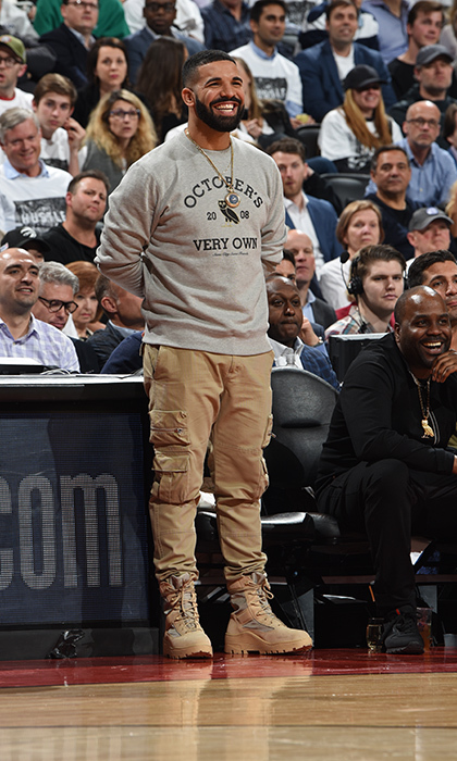 <p>You can always catch Drake cheering courtside! The rapper looked dapper as ever at a Toronto Raptors game on April 17.</p>