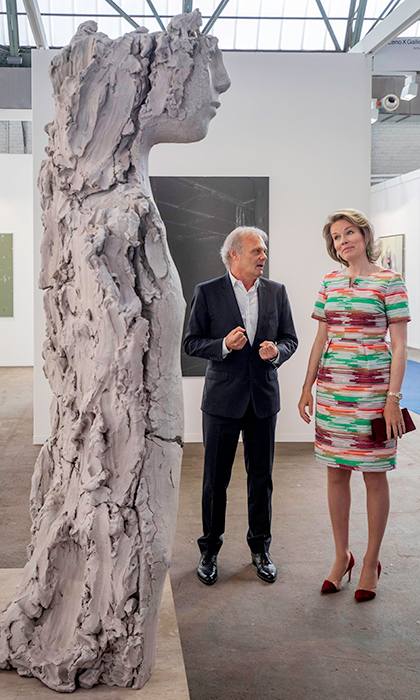 <p>Queen Mathilde looked spring ready in a colourful structure dress with matching maroon heels. The Dutch royal was visiting the Contemporary Art Fair on April 19 in Brussels.</p>