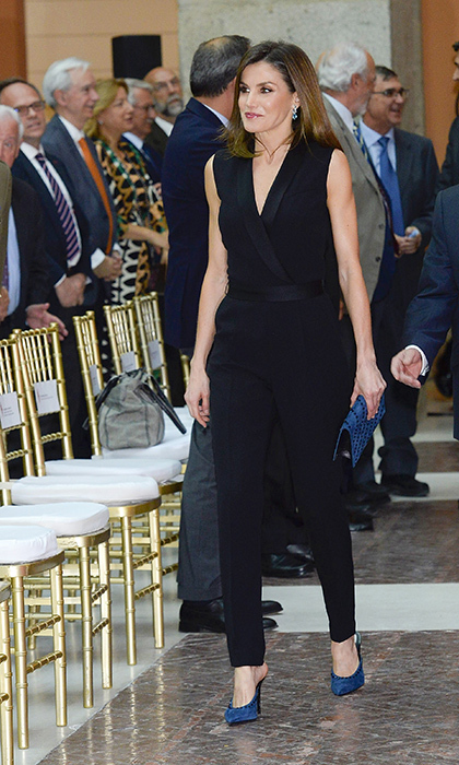 <p>Queen Letizia was the picture of chic in a black tuxedo jumpsuit and royal blue heels. The royal was attending the SM 'Barco de Vapor' and 'Gran Angular' children and youth literary awards at the Real Casa de Correos on April 18.</p>