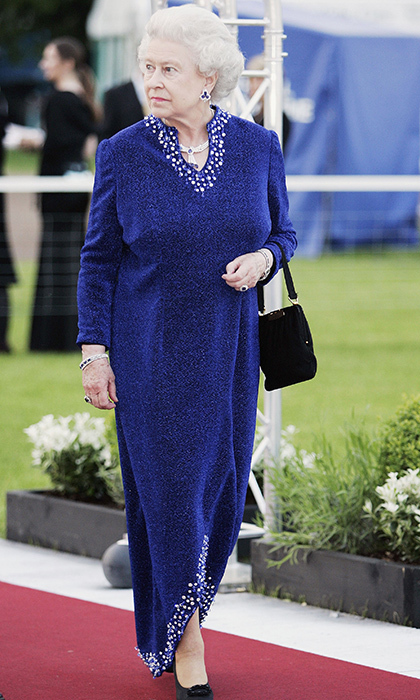 <p>The Queen dazzled in a glamorous blue gown while at the Royal Windsor Horse Show dinner in 2006.