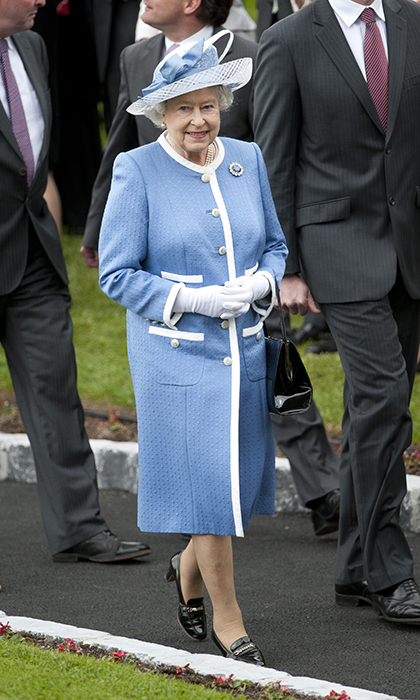 <p>Another one of our favourite blue looks was this one she donned while visiting Ireland with <A href=/tags/0/prince-philip><strong>Prince Philip</a></strong> in 2011.