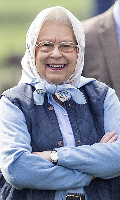 <p>The Queen looked casual in this blue ensemble while watching her horse Barbershop win its class at the Royal Windsor Horse show in 2016.