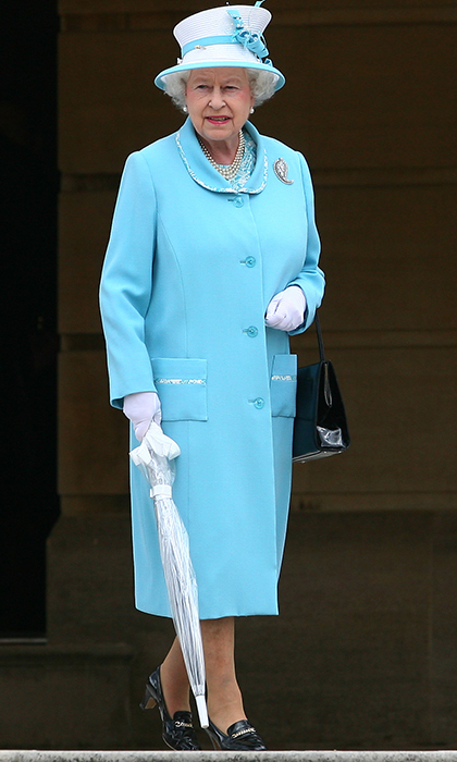 <p>The Queen hosted a garden party at Buckingham Palace in 2010, stunning in this aqua blue get-up.