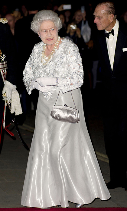 <p>Her Majesty stunned in silver at London's Royal Opera House in 2012.</p>