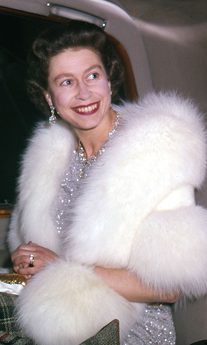 <p>The Queen looked radiant in a fur stole at the Indian embassy in London in 1961.</p>
