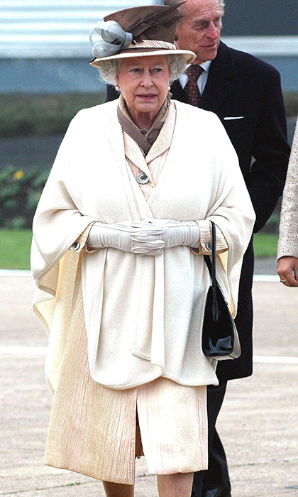 <p>While arriving at Heathrow Airport in 2005, the Queen looked spring ready in cream.</p>