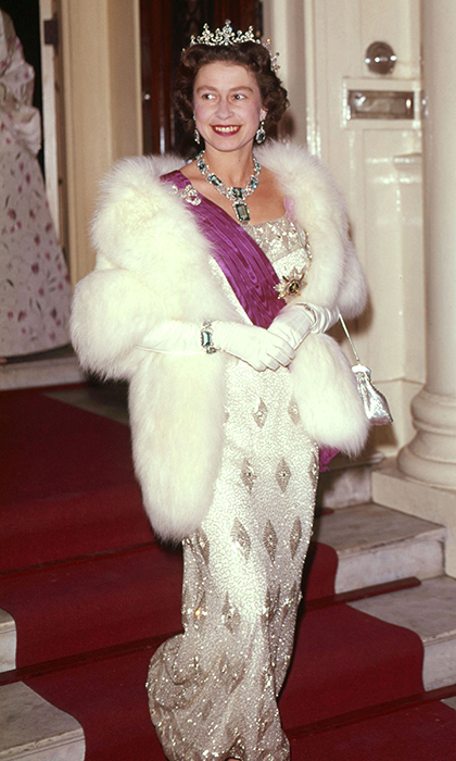 <p>Fur and jewels and glitter, oh my! Her Majesty looked totally elegant at the Belgian Embassy banquet in 1963.</p>