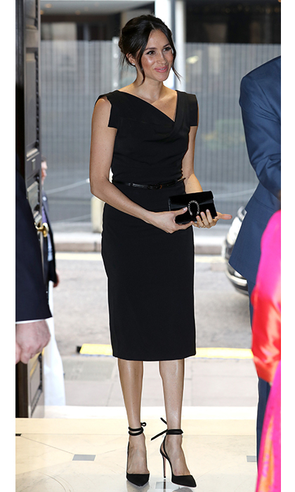 <p>Meghan was the picture of chic in a stunning Black  Halo dress, matching black pumps and her classic messy bun.