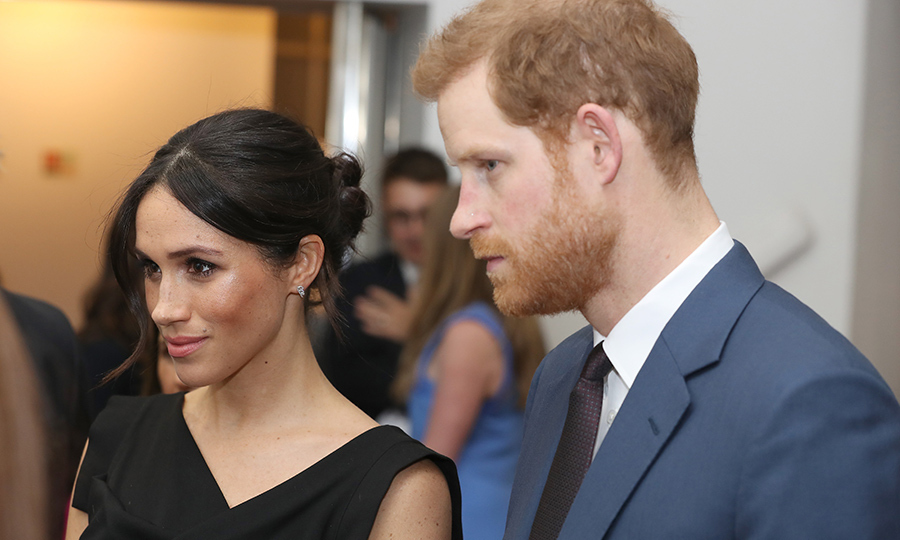 <p>The couple listened intently while chatting with Foreign Secretary Boris Johnson and attendees.