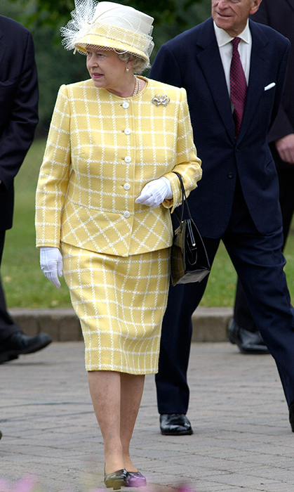 <p>The Queen checked all the style boxes in this fabulous yellow-and-white check outfit while visiting Windsor's Legoland theme park in 2003.