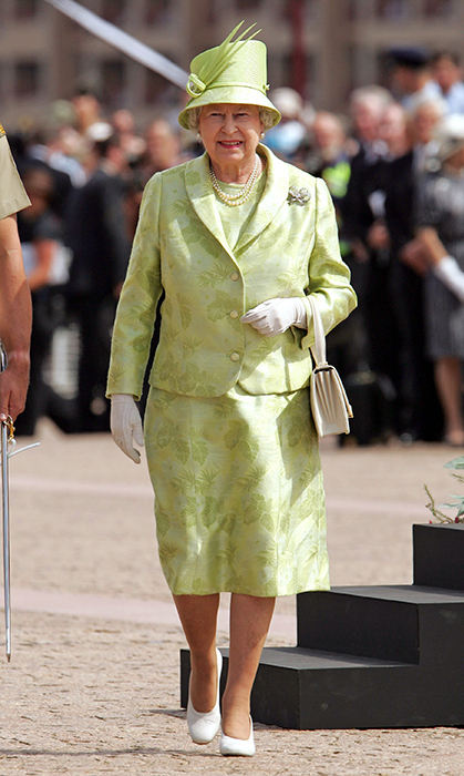 <p>We love this jacquard look Her Majesty wore while visiting Australia in 2006 with her husband.