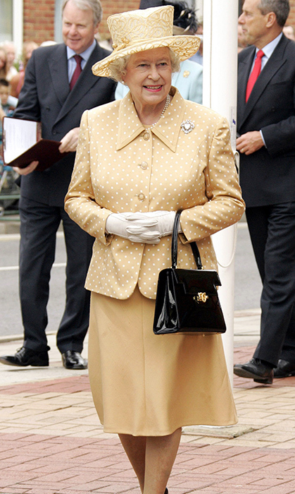 <p>While at an engagement in Kent in 2005, the Queen looked happy as a clam in this incredible polkadot number and patent black purse.