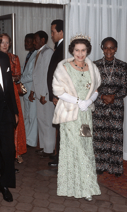 <p>The Queen loves mint green just as much as the next girl! She wore this dazzling lace number – with elbow-high gloves and a fur shawl – while attending the 1979 state dinner in Botswana.