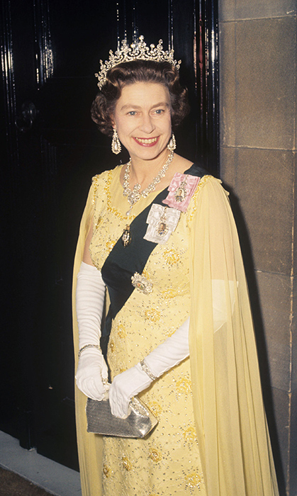 <p>Her Majesty's smile dazzled as bright as her jewels and sunny gown in Scotland in 1972! Here, she donned the sash of the Order of the Thistle.