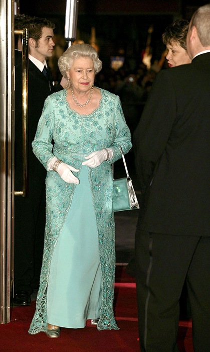 <p>This was one of Queen Elizabeth's looks for the books. Dressed head-to-toe in teal, she shined while at Edinburgh Festival Theatre in 2003.