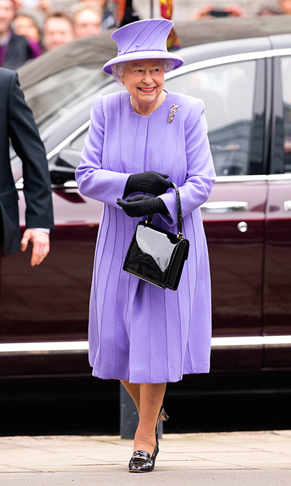 <p>The Queen looked perfect in this pleated purple number while visiting the University of London in 2013.