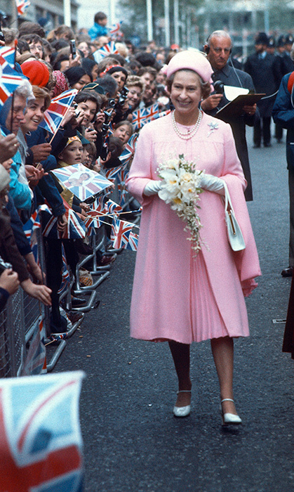 <p>Queen Elizabeth wore this pink perfection on a walkabout in London in 1977.