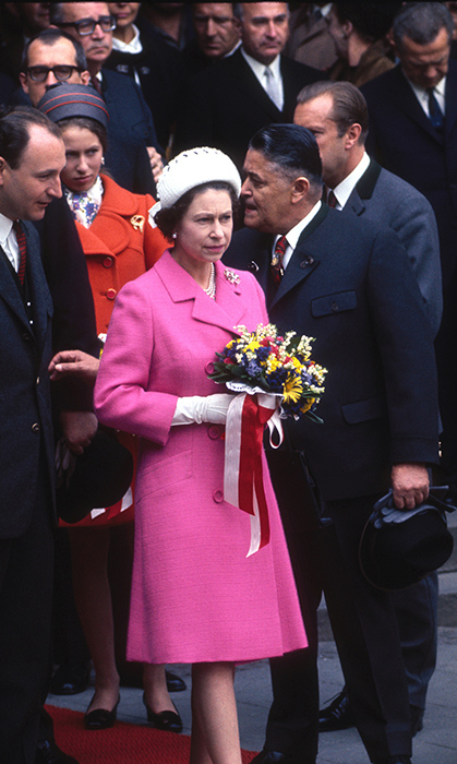 <p>Another favourite colour of the Queen is magenta, which she wore here to the wedding of Princess Margriet of the Netherlands in 1967.