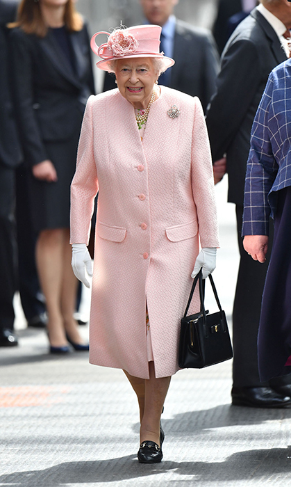 <p>We love this pink-peach perfection the Queen wore while visiting Liverpool in 2016.