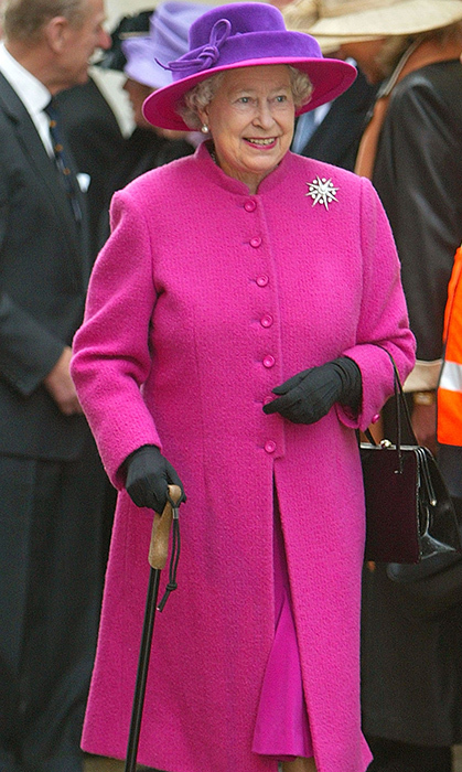 <p>Magenta and purple is one of the Queen's reigning combos! She wore it this time while attending an engagement in Southhampton in 2004.