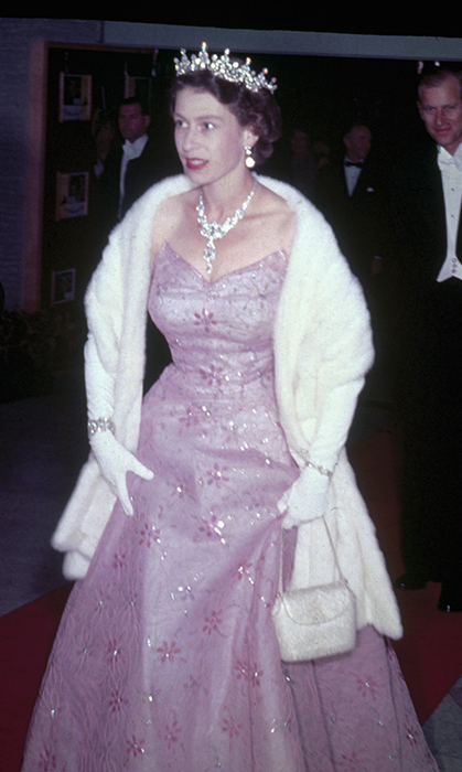 <p>The new Queen was only 25 when she wore this glittery purple gown while on a visit to Malta in 1951.