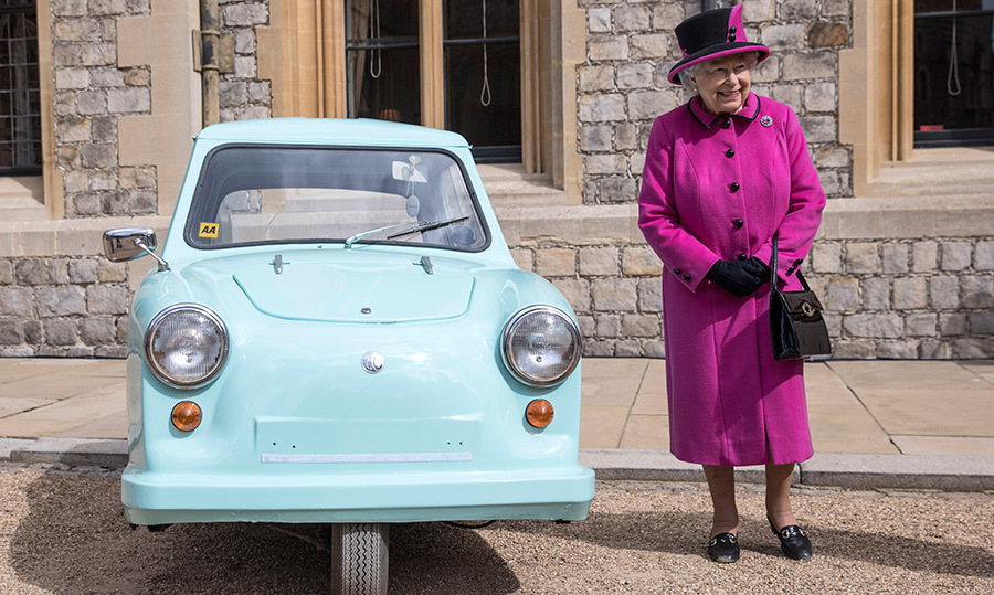 <p>The Queen posed beside a tiny car while hosting a ceremony at Windsor Castle in 2017.