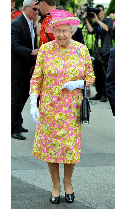 <p>No one can rock neon green <em>and</em> pink together quite like Her Majesty can! Here, she stepped out in Winnipeg during an eight-day tour of Canada in 2010.