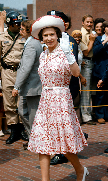 <p>While visiting Boston in 1976, Her Majesty was the picture of summery in this red-and-white floral dress. She pulled the look together with a matching hat.
