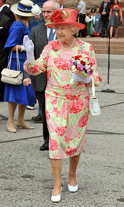<p>No floral is too much floral. The Queen wore this colourful design, paired with a flower hat and a bouquet, while in Toronto on her 2010 tour of Canada.