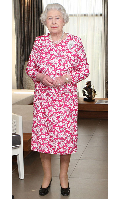 <p>Pink and white is always a staple colour combo! The Queen looked classy as ever while visiting Trinidad in 2009.