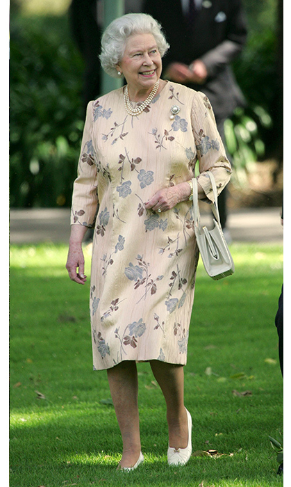 <p>The Queen looked elegant in a more subdued floral dress while at a tree planting ceremony in Australia back in 2006.