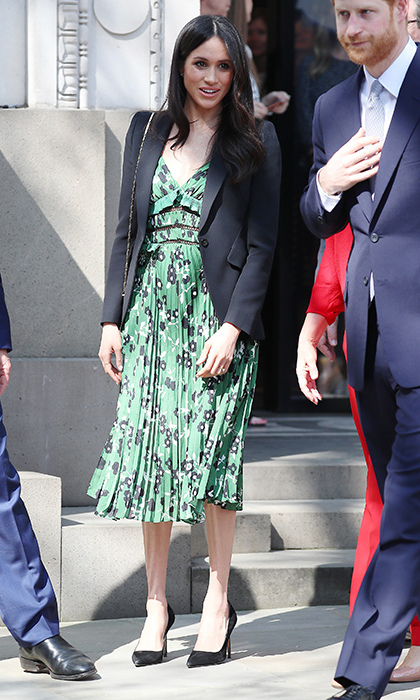 With one month until her royal wedding, the bride-to-be stunned in another gorgeous ensemble as she joined fiancé Prince Harry, patron of the Invictus Games Foundation, at the Invictus Games reception on April 21. For a look that suited the warm weather London was having, she turned to celebrity favourite Self-Portrait, slipping into the pretty green Cold Shoulder Floral Midi Dress, which retails for $675. Meghan topped off the flouncy number with a black blazer and a pair of sleek black pumps. Once again, she styled her long brunette hair in loose waves and kept her makeup soft and simple.