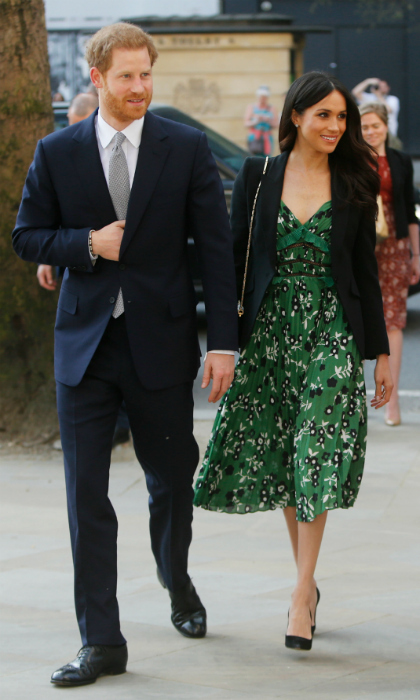 The royal-to-be kept cool in a green floral midi dress by contemporary design label Self-Portrait. 