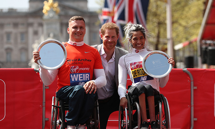 Prince Harry posed with wheelchair winners David Weir, from Britain, and Australia's Madison de Rozario. 
