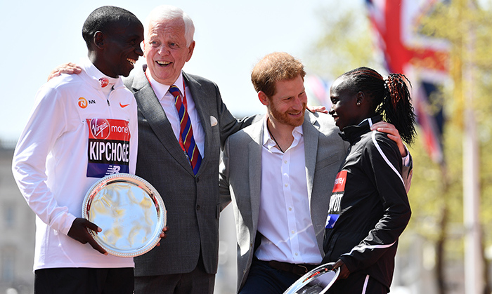 As patron of the London Marathon Charitable Trust, Prince Harry paid a visit to the annual event to cheer on competitors in the elite men, women, wheelchair and IPC races. His enthusiasm was infectious as he chatted with the first-aid team, marathon staff and winners! Here, he posed with Kenya's Eliud Kipchoge and Vivian Cheruiyot, who took first place in the elite men's and elite women's races on Sunday (April 22).