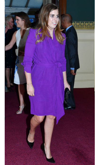 Princess Beatrice wore a purple wrap dress with black accessories. 