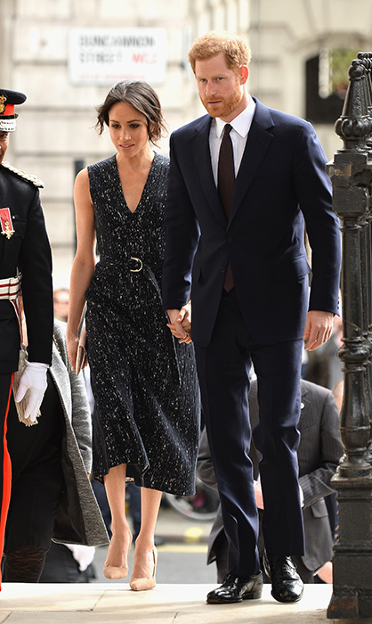 <p>Meghan looked gorgeous in a navy belted dress by BOSS and beige pumps.