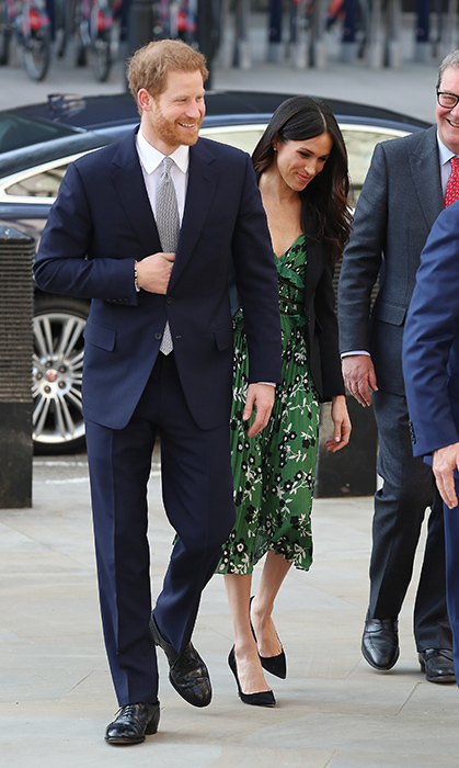 <p>Meghan dazzled in a green Self Portrait dress, a tailored black blazer and black suede heels.
