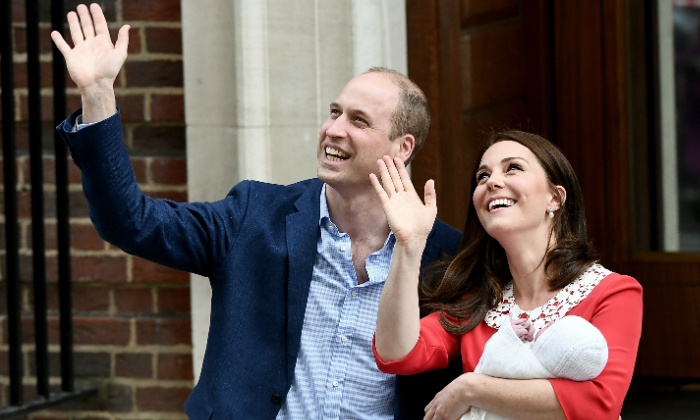 In a scene reminiscent of Prince George and Princess Charlotte's debuts in 2013 and 2015, respectively, the proud parents were greeted by cheers of congratulations outside the hospital. 
