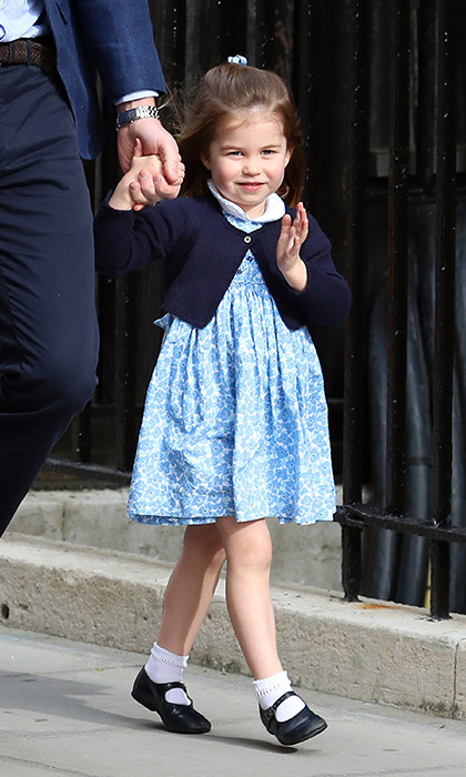 <p>Little Princess Charlotte was all dressed in blue to meet her baby brother for the first time on April 23. She stole the show with an adorable wave while walking hand-in-hand with her father, Prince William.</p>