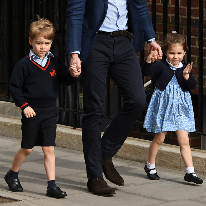 <p>Prince George may have been a little nervous about meeting his newborn baby brother, but that didn't take away from how adorable this moment was. George and his charming sister, Princess Charlotte, walked hand-in-hand with their father towards the Lindo Wing steps.</p>