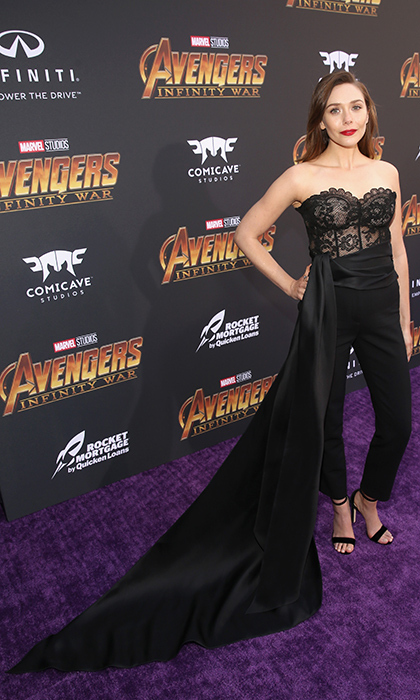 <p>Elizabeth Olsen went with a lace tuxedo jumpsuit and sported the longest train!</p>