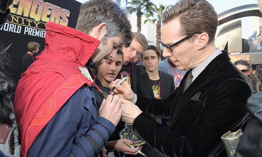 <p>The <em>Sherlock Holmes</em> star signed some autographs.</p>