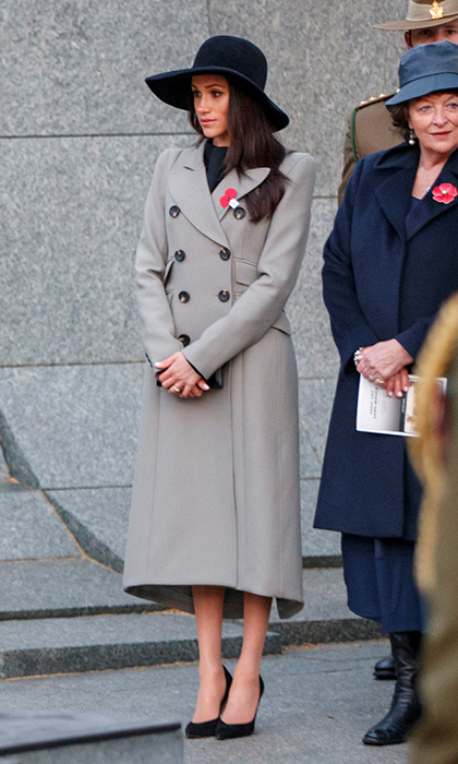 Meghan Markle slipped on a gorgeous grey coat by Canadian label Smythe to keep the early morning chill at bay as she attended a somber dawn service on Anzac Day at Hyde Park Corner in London. The royal bride-to-be anchored the look with black suede Sarah Flint 'Jay' pumps and topped it off with a wide-brimmed black hat. 