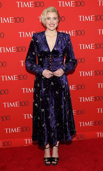 <p>Greta Gerwig stunned in a crushed velvet navy Gucci gown. The director shot to stardom this year with her latest Oscar nominated film, <em>Lady Bird</em>.</p>