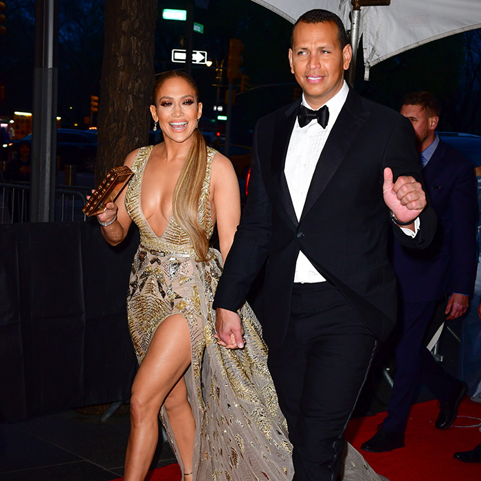 <p>They've arrived! Jennifer Lopez and Alex Rodriguez waved to the crowds.</p>