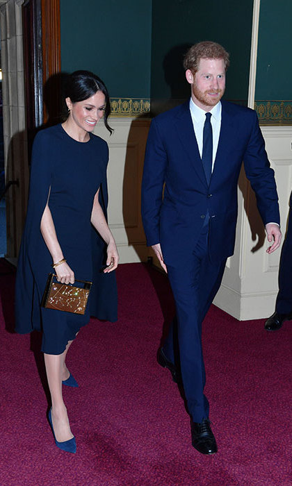 <p>The bride-to-be wowed in a caped Stella McCartney dress for the Queen's 92nd birthday event. Rocking her classic messy bun, she accessorized with a Naeem Khan 'Leo' clutch bag and her Manolo Blahnik navy suede BB heels.</p>