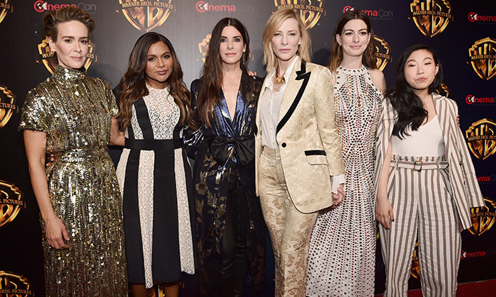 The cast of <em>Ocean's 8</em> was a sartorial feast for the eyes at Warner Bros. Picture's The Big Picture event. Sarah Paulson stunned in glitzy gold Alberta Ferretti, Mindy Kaling donned lacy black and white Stella McCartney, Sandra Bullock was too-cool in Johanna Ortiz's Wasai kimono and leather pants, Cate Blanchett rocked a cream jacquard Gucci tuxedo, Anne Hathaway slipped into an embellished Bottega Veneta dress and Awkwafina opted for a striped suit by Topshop.   